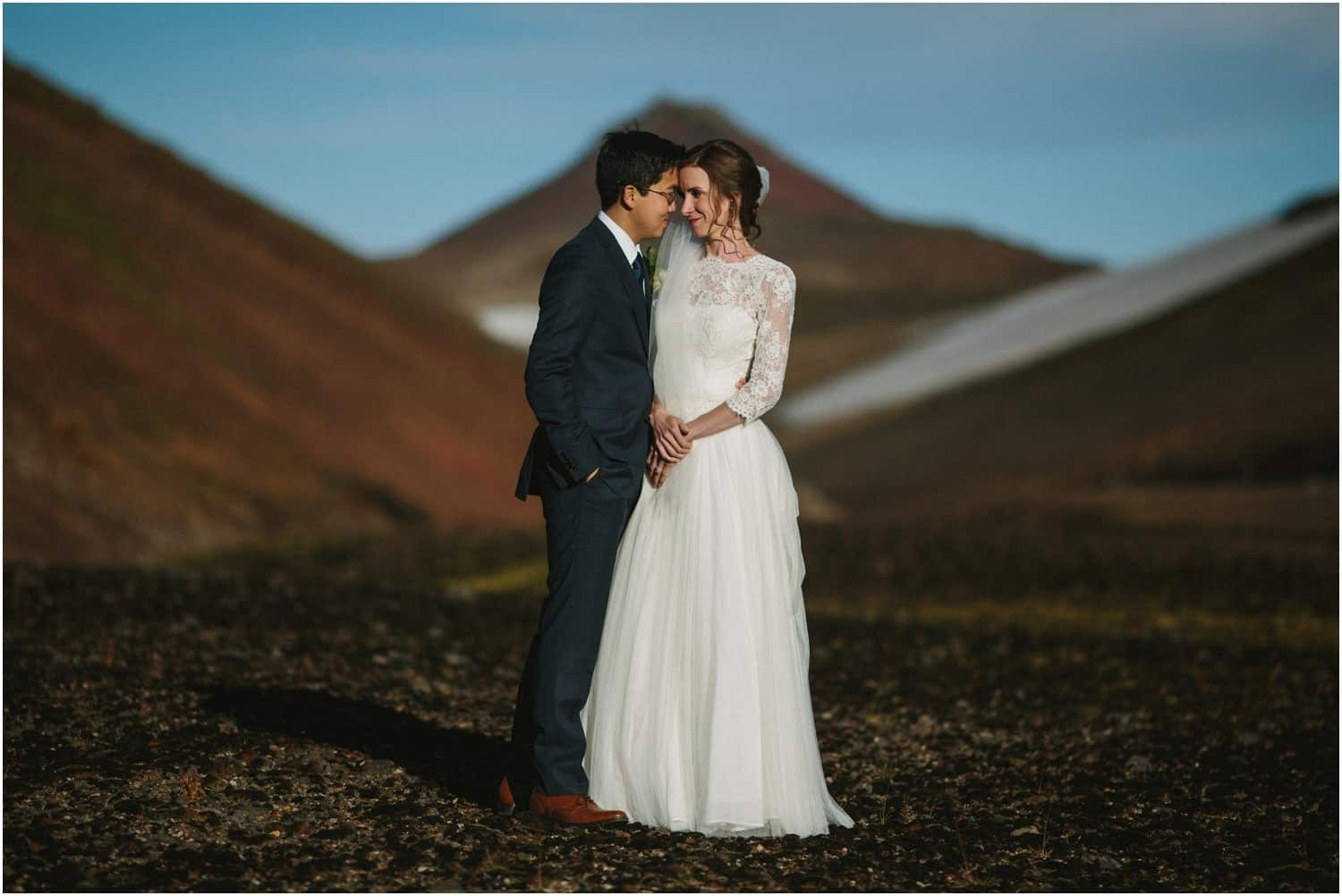 A newly married couple post during their Iceland elopement