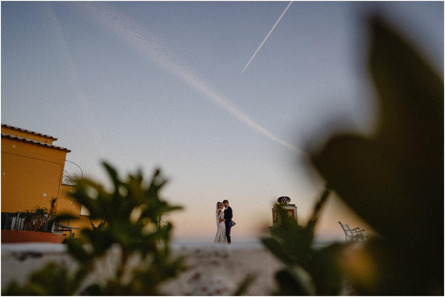 A newly married couple at sunset at their Villa Oliviero Positano wedding