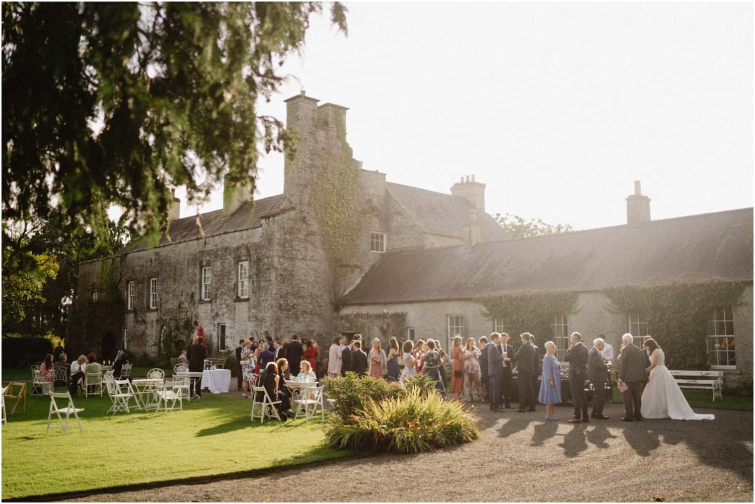 Guests mingle at a Durhamstown Castle wedding