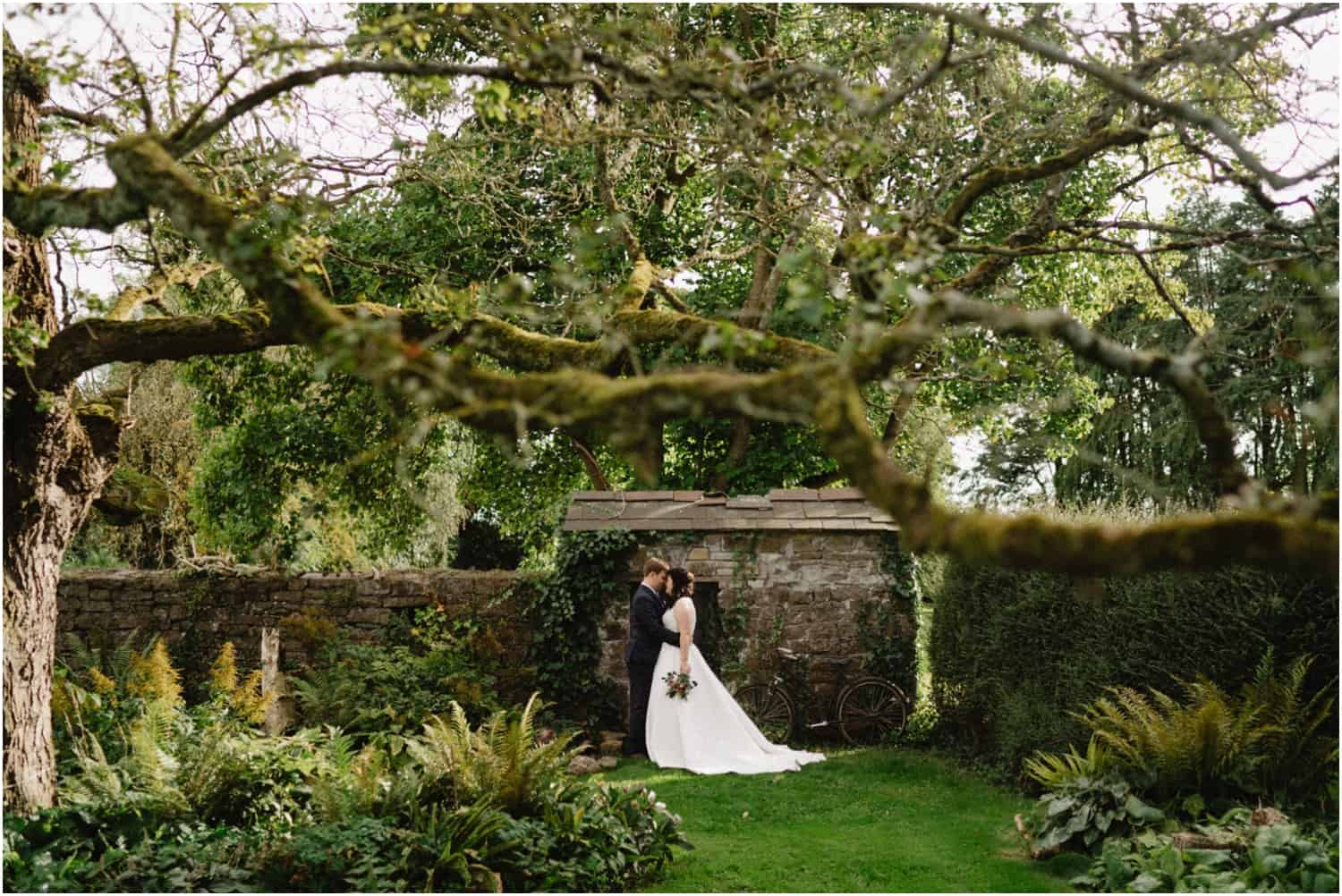 A newly married couple pose for a photo at their Durhamstown Castle wedding